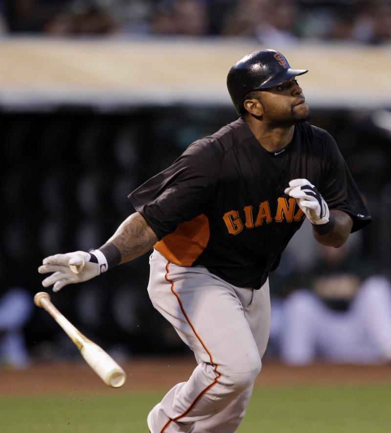 San Francisco Giants' Pablo Sandoval drives in a run with a double against the Oakland Athletics during the second inning of a spring training baseball game in Oakland, Calif., Tuesday, March 29, 2011. (AP Photo/Marcio Jose Sanchez)