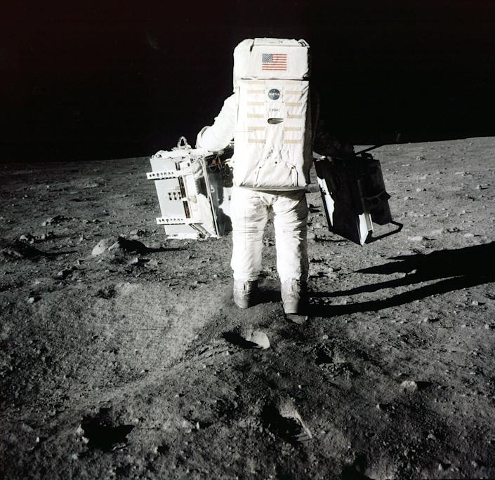 Buzz Aldrin carries scientific experiments to a deployment site south of the lunar module Eagle, July 20, 1969. Photo was taken by Neil Armstrong of the Apollo 11 mission. | Neil Armstrong/AP