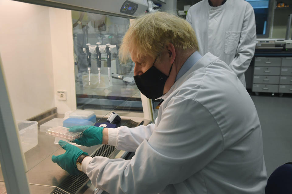 British Prime Minister Boris Johnson during a visit to The National Institute for Biological Standards, in South Mimms, England, Monday June 21, 2021. (Jeremy Selwyn/Pool via AP)