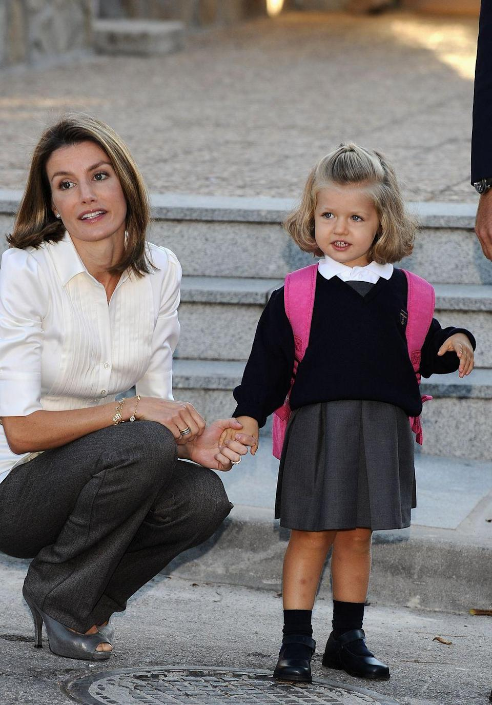 <p>Princess Leonor of Spain attends her first day accoompanied by her mother, Princess Letizia and her father, Prince Felipe (not pictured), at Santa Maria de los Rosales School in Aravaca, near Madrid, Spain.</p>