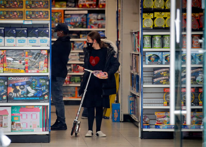 FILE PHOTO: A young Ultra-Orthodox Jewish girl shops in a toy store, during the outbreak of coronavirus disease (COVID-19) in the Borough Park section of Brooklyn, New York
