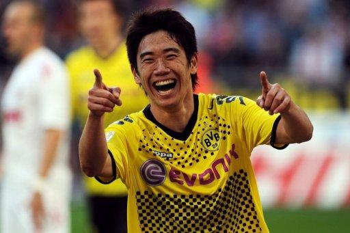 Japan midfielder Shinji Kagawa has joined Manchester United