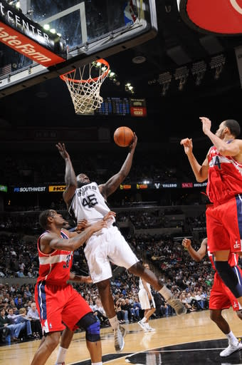 SAN ANTONIO, TX - MARCH 12: DeJuan Blair #45 of the San Antonio Spurs grabs a rebound against Trevor Booker #35 of the Washington Wizards on March 12, 2012 at the AT&T Center in San Antonio, Texas