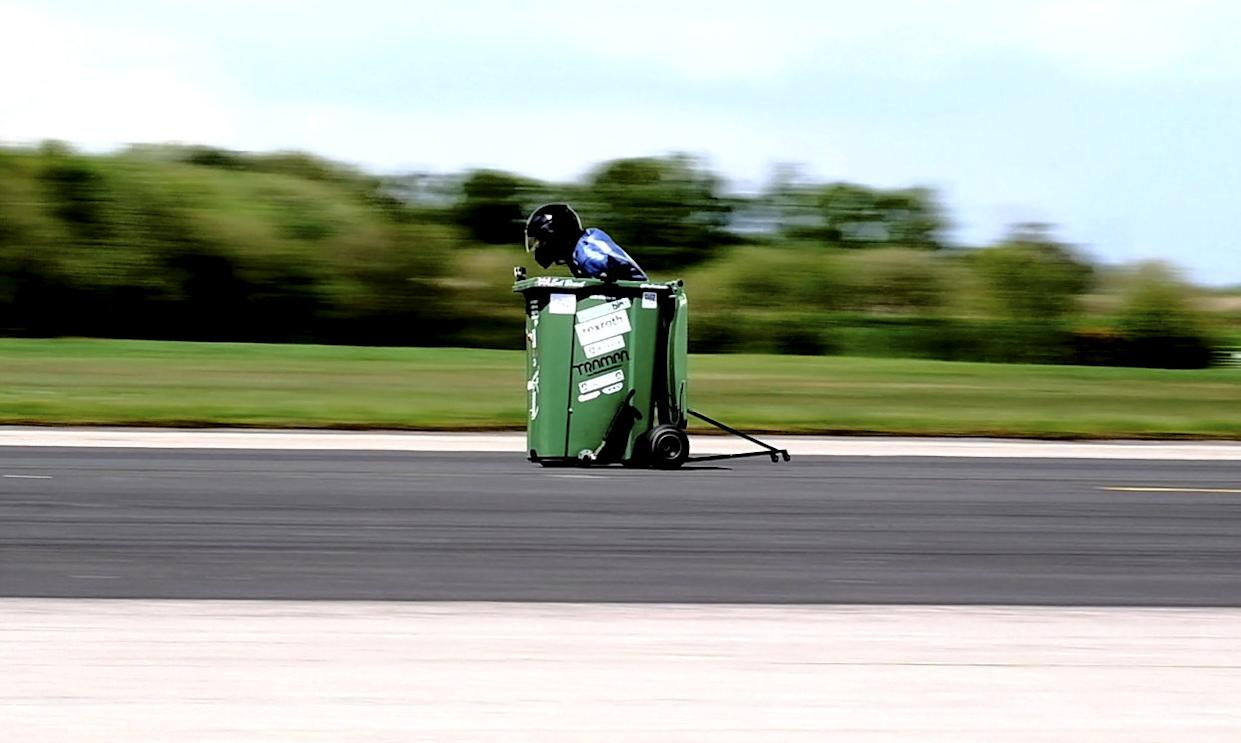 Andy Jennings who set a new wheelie bin Guinness world speed record. (SWNS)