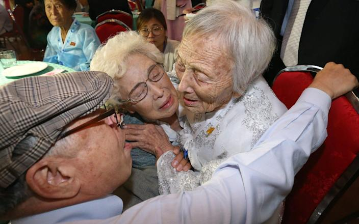 South Koreans Jo Hye-do, 86, and Jo Do-jae, 75, meet their North Korean sister Jo Soon Do, 89 - AFP