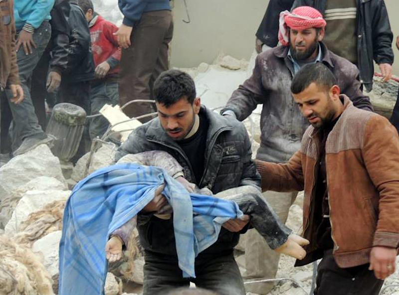 This citizen journalism image taken on Tuesday, Feb. 19, 2013 and provided by Aleppo Media Center AMC which has been authenticated based on its contents and other AP reporting, shows a Syrian man carrying a girl's body in the aftermath of a strike by Syrian government, in the neighborhood of Jabal Bedro, in Aleppo, Syria. (AP Photo/Aleppo Media Center AMC)
