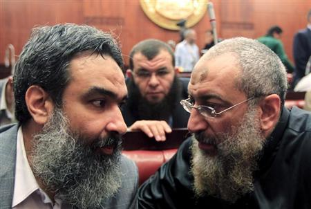 Salafist cleric leader Borhamy speaks with al-Zarqa, one of the advisors to Egypt's President Mursi, at the Shura Council during the final vote on a draft new Egyptian constitution in Cairo