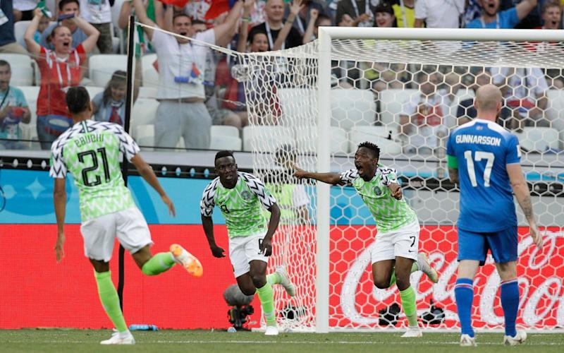 Ahmed Musa celebrates scoring the first of his two goals - AP