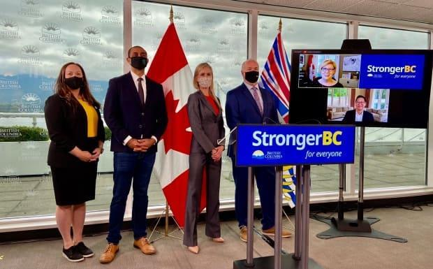 B.C. Premier John Horgan; Carla Qualtrough, Canada's Minister of Employment, Workforce Development, and Disability Inclusion, Susannah Pierce, Shell Canada president and country chair and Ravi Kahlon, B.C. minister for an innovation and clean energy make an announcement on July 16, 2021. (Government of B.C. - image credit)
