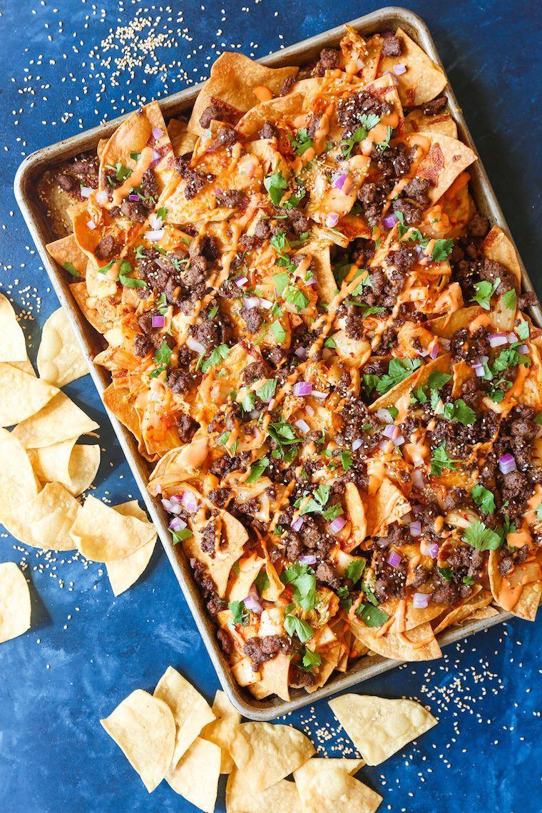 """<p>A sheet of nachos is always a hit on game day. Try this recipe that has Korean beef, caramelized kimchi, and Sriracha mayo.</p><p><strong>Get the recipe at <a href=""""https://damndelicious.net/2018/09/23/korean-beef-nachos/"""" rel=""""nofollow noopener"""" target=""""_blank"""" data-ylk=""""slk:Damn Delicious"""" class=""""link rapid-noclick-resp"""">Damn Delicious</a>.</strong></p><p><strong><a class=""""link rapid-noclick-resp"""" href=""""https://go.redirectingat.com?id=74968X1596630&url=https%3A%2F%2Fwww.walmart.com%2Fsearch%2F%3Fquery%3Dsheet%2Bpan&sref=https%3A%2F%2Fwww.thepioneerwoman.com%2Ffood-cooking%2Fmeals-menus%2Fg35049189%2Fsuper-bowl-food-recipes%2F"""" rel=""""nofollow noopener"""" target=""""_blank"""" data-ylk=""""slk:SHOP SHEET PANS"""">SHOP SHEET PANS</a><br></strong></p>"""