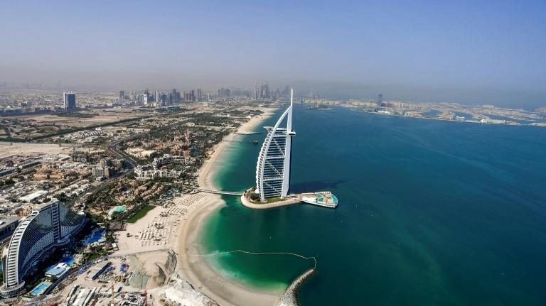 A view of the Burj al-Arab hotel in the Gulf emirate of Dubai, with the man-made Palm Jumeirah archipelago seen in the background