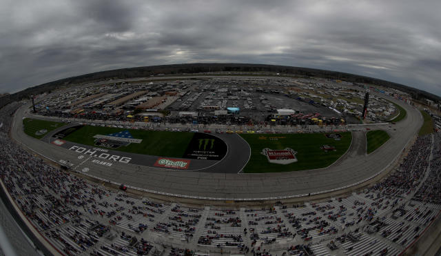 Rain clouds hang over Atlanta Motor Speedway before the start of the NASCAR Cup Series auto race at Atlanta Motor Speedway in Hampton, Ga., on Sunday, Feb. 25, 2018. NASCAR was able to start the race after a rainy morning. (AP Photo/Paul Abell)