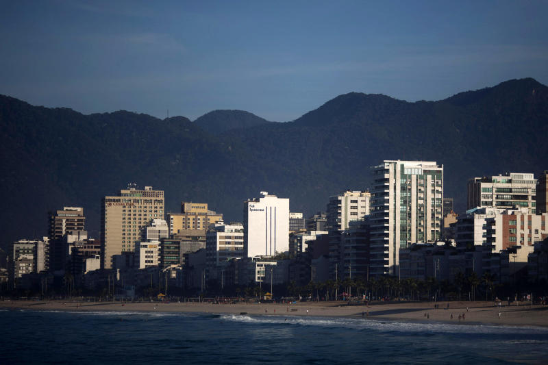 In this May 23, 2012 photo, beachfront apartments overlook the ocean along Ipanema in Rio de Janeiro, Brazil. Brazil's burgeoning middle class is moving up in the world, into fancier high-rises. The discovery of vast oil deposits off the coast has flooded the city with renters carrying fistfuls of petrodollars. And property owners already are hiking rents in anticipation of Rio's upcoming mega-events, the 2014 soccer World Cup and 2016 Olympics. (AP Photo/Felipe Dana)