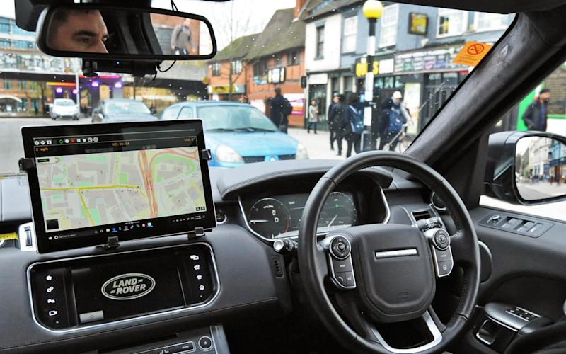 A Jaguar Land Rover research vehicle equipped with self-driving technology makes its way through Coventry - PA