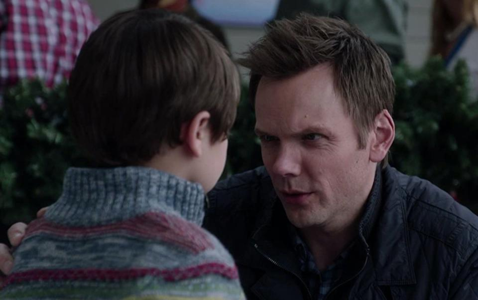 joel mchale and young child movie still