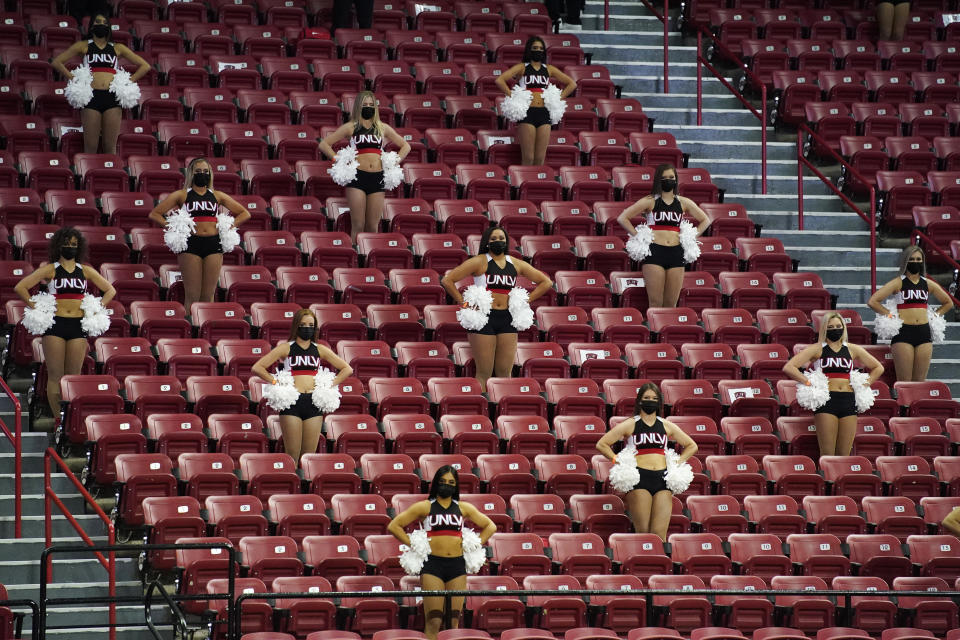 UNLV cheerleaders in the stands against Fresno State during the second half of an NCAA college basketball game Wednesday, Feb. 24, 2021, in Las Vegas. (AP Photo/John Locher)