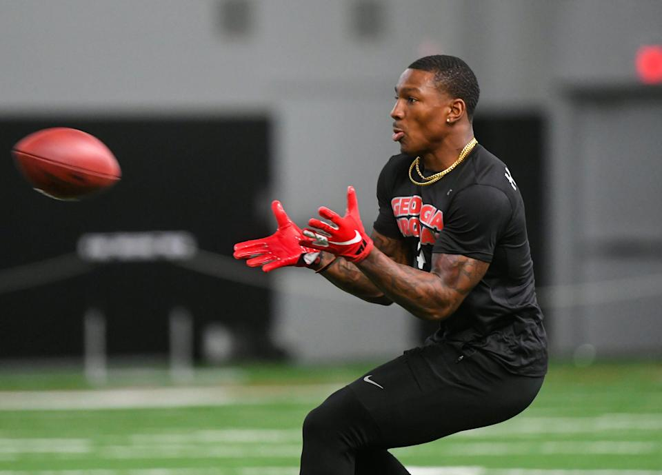 Georgia wide receiver Mecole Hardman prepares to catch a football during Georgia Pro Day, Wednesday, March 20, 2019, in Athens, Ga. (AP Photo/John Amis)