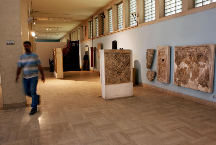 A man visits the restored Iraqi National Museum in Baghdad, Iraq, Monday, April 1, 2013. Tens of thousands of artifacts chronicling some 7,000 years of civilization in Mesopotamia are believed to have been looted from Iraq in the chaos which followed the the US-led invasion in 2003. Despite international efforts to track items down, fewer than half of the artifacts have so far been retrieved. (AP Photo/Hadi Mizban)