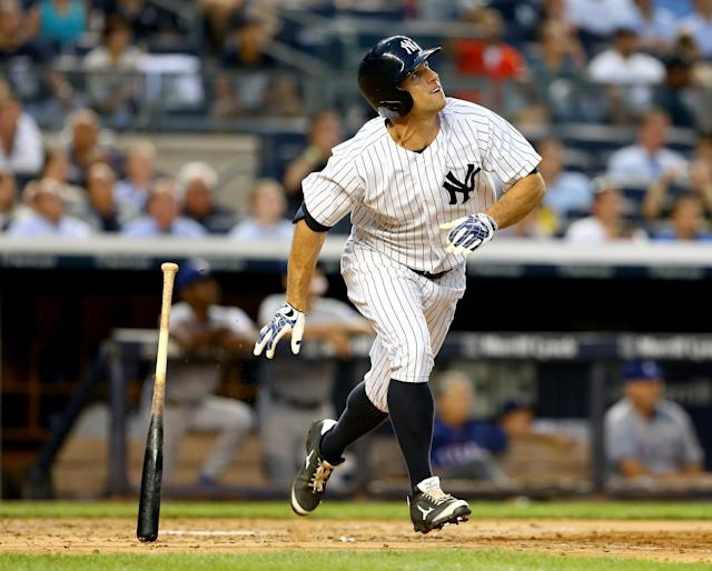 NEW YORK, NY - JULY 23: Brett Gardner #11 of the New York Yankees hits a solo home run in the third inning against the Texas Rangers on July 23, 2014 at Yankee Stadium in the Bronx borough of New York City. (Photo by Elsa/Getty Images)