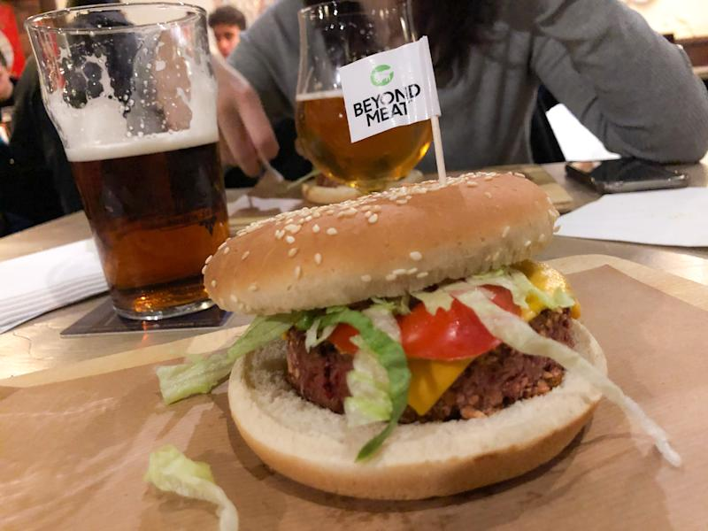 Beyond Meat hamburger is seen in a pub in Milan, Italy, on January 04 2020. Beyond Meat is a Los Angeles-based producer of plant-based meat substitutes founded in 2009 by Ethan Brown. The company's initial products became available across the United States in 2012.The company has products designed to simulate chicken, beef, and pork sausage.According to a life cycle assessment (LCA) of the Beyond Burger from the University of Michigan, the Beyond Burger generates 90% less greenhouse gas emissions, requires 46% less energy, has >99% less impact on water scarcity and 93% less impact on land use than a ¼ pound of U.S. beef. (Photo by Mairo Cinquetti/NurPhoto via Getty Images)
