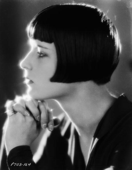 "<p>Actress Louise Brooks was known for her dark angularly bob during the height of her fame in the 1920s. This cut <a href=""https://www.bfi.org.uk/news-opinion/news-bfi/features/louise-brooks-lulu-bob-haircut"" rel=""nofollow noopener"" target=""_blank"" data-ylk=""slk:became one of the trendiest styles"" class=""link rapid-noclick-resp"">became one of the trendiest styles</a> of the art deco era. </p>"