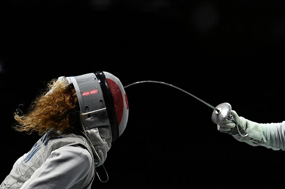 <p>Canada's Eleanor Harvey (L) compete against France's Ysaora Thibus in the women's foil team quarter-final bout during the Tokyo 2020 Olympic Games at the Makuhari Messe Hall in Chiba City, Chiba Prefecture, Japan, on July 29, 2021. (Photo by Mohd RASFAN / AFP)</p>