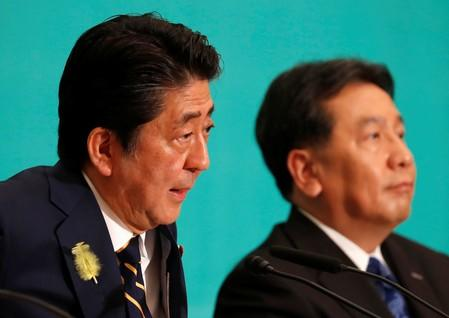Japan's Prime Minister Shinzo Abe, who is also ruling Liberal Democratic Party leader, and Constitutional Democratic Party of Japan leader Yukio Edano attend a debate session ahead of July 21 upper house election with other party leaders in Tokyo