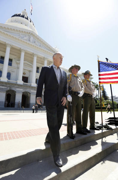FILE - In this April 23, 2013 file photo, Gov. Jerry Brown walks to the west steps of the Capitol to address a crime victims rally in Sacramento, Calif. In his second stint as California's chief executive, Brown has received wide praise for bringing the state's massive budget deficit into line, but he also is seeking billions of dollars in infrastructure spending, which could lead to financial pitfalls for the state. (AP Photo/Rich Pedroncelli, File)