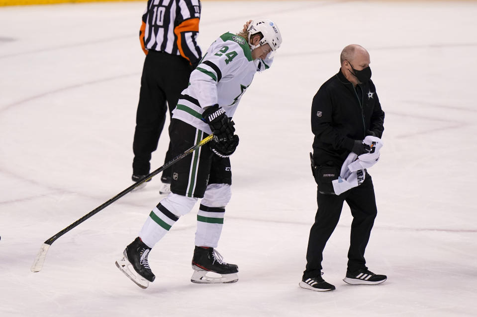 Dallas Stars left wing Roope Hintz (24) walks off after falling to the ice during the first period of an NHL hockey game against the Florida Panthers, Monday, Feb. 22, 2021, in Sunrise, Fla. (AP Photo/Lynne Sladky)