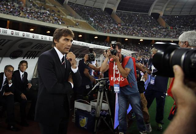 Italy coach Antonio Conte waits for the start of a friendly soccer match between Italy and The Netherlands in Bari, Italy, Thursday, Sept. 4, 2014. (AP Photo/Gregorio Borgia)