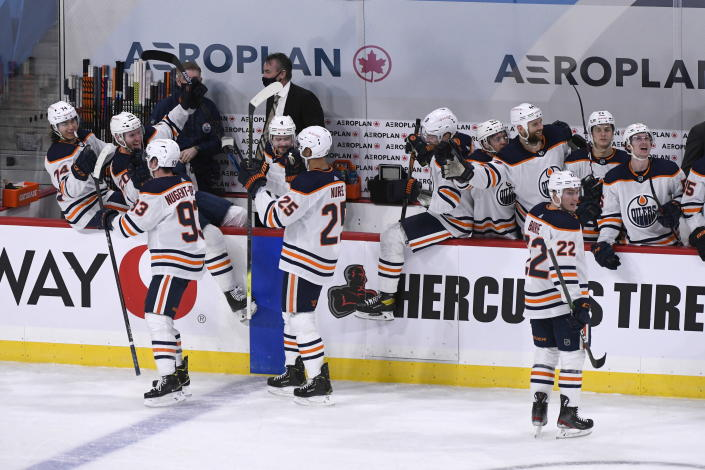 The Edmonton Oilers bench celebrates after their game-winning goal with less than a second left against the Winnipeg Jets in an NHL hockey game, Sunday, Jan. 24, 2021, in Winnipeg, Manitoba. (Fred Greenslade/The Canadian Press via AP)