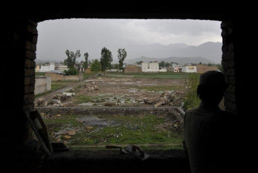 A labourer is seen working at a house in front of the demolished compound of slain Al-Qaeda leader Osama bin Laden, in northern Abbottabad. A year after bin Laden died in a US raid, Al-Qaeda keeps spreading its message of terror in Pakistan, analysts say, with splinter groups threatening the country's fragile stability