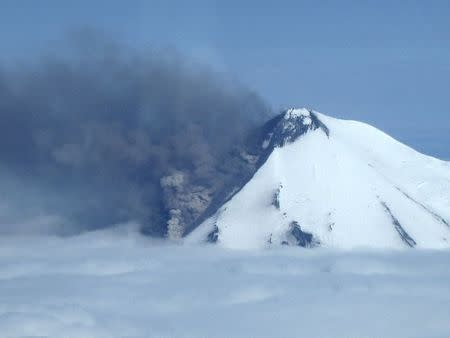 Smoke pours from the erupting Pavlof Volcano on the Alaska Peninsula