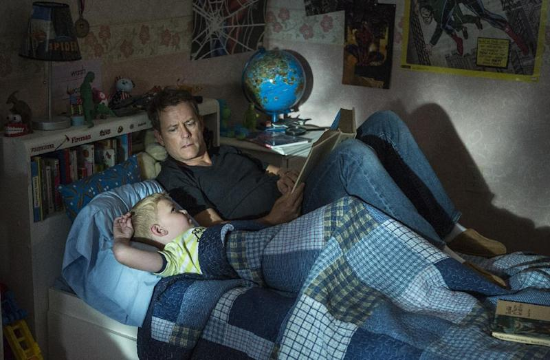 """This image released by Sony Pictures shows Connor Corum, left, and Greg Kinnear in a scene from """"Heaven Is For Real."""" (AP Photo/Sony Pictures, Allen Fraser)"""