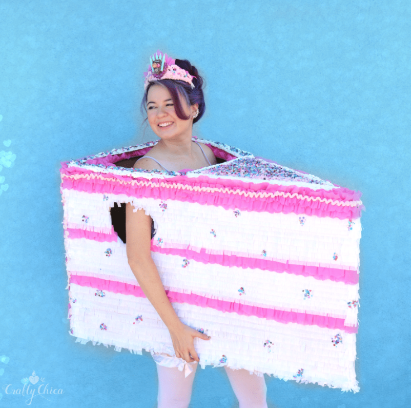 """<p>This cake costume by <strong>Kathy Cano-Murillo</strong> uses leftover boxes and party streamers. Don't worry: She has a video tutorial that explains all the steps!</p><p><strong>Get the tutorial at <a href=""""https://craftychica.com/2017/10/cake-slice-boxtume-tutorial/"""" rel=""""nofollow noopener"""" target=""""_blank"""" data-ylk=""""slk:The Crafty Chica"""" class=""""link rapid-noclick-resp"""">The Crafty Chica</a>.</strong></p>"""