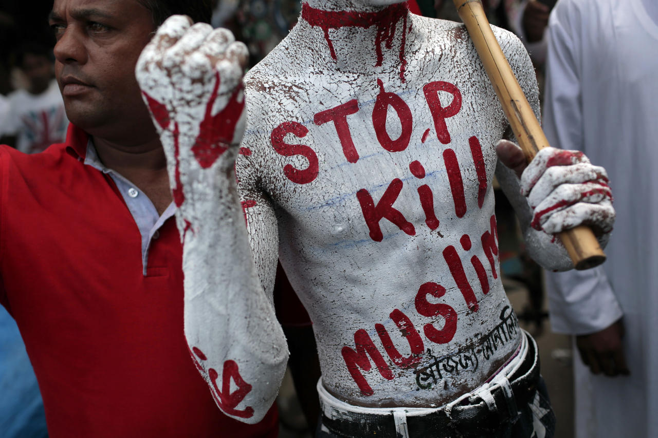 <p>A Bangladeshi man Mohammad Tutul, body painted with a slogan, attends a protest rally against the persecution of Rohingya Muslims in Myanmar, after Friday prayers in Dhaka, Bangladesh, Friday, Sept. 15, 2017. (Photo:A.M. Ahad/AP) </p>