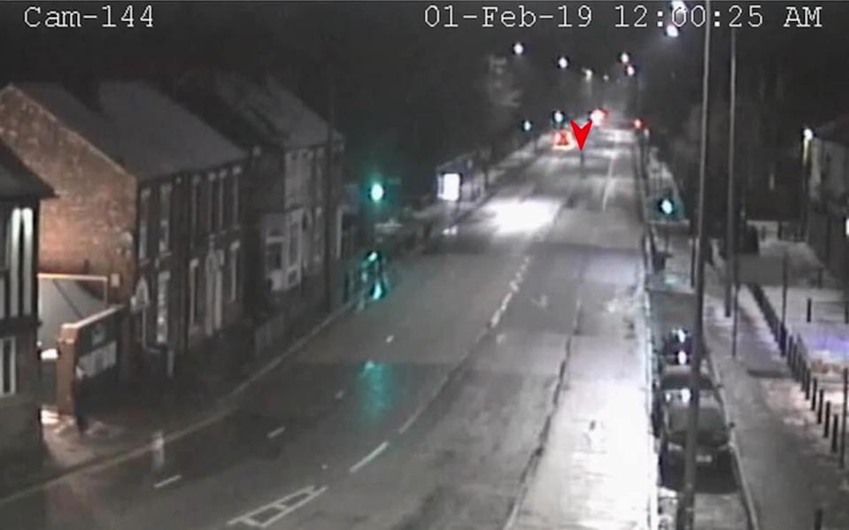 Pawel Relowicz (red arrow) is seen darting across the road to intercept Libby Squire - Humberside Police