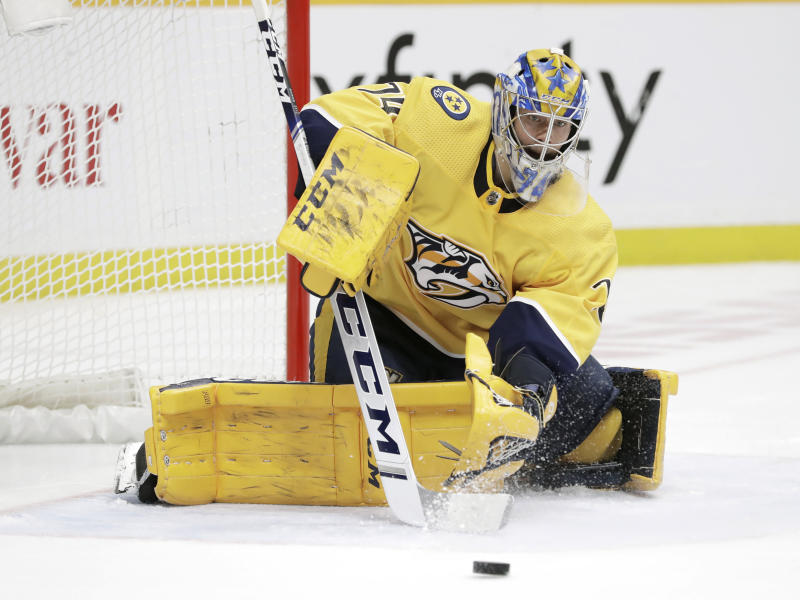 Nashville Predators goaltender Juuse Saros, of Finland, stops a shot by the Pittsburgh Penguins during the third period of an NHL hockey game Friday, Dec. 27, 2019, in Nashville, Tenn. The Penguins won 5-2. (AP Photo/Mark Humphrey)