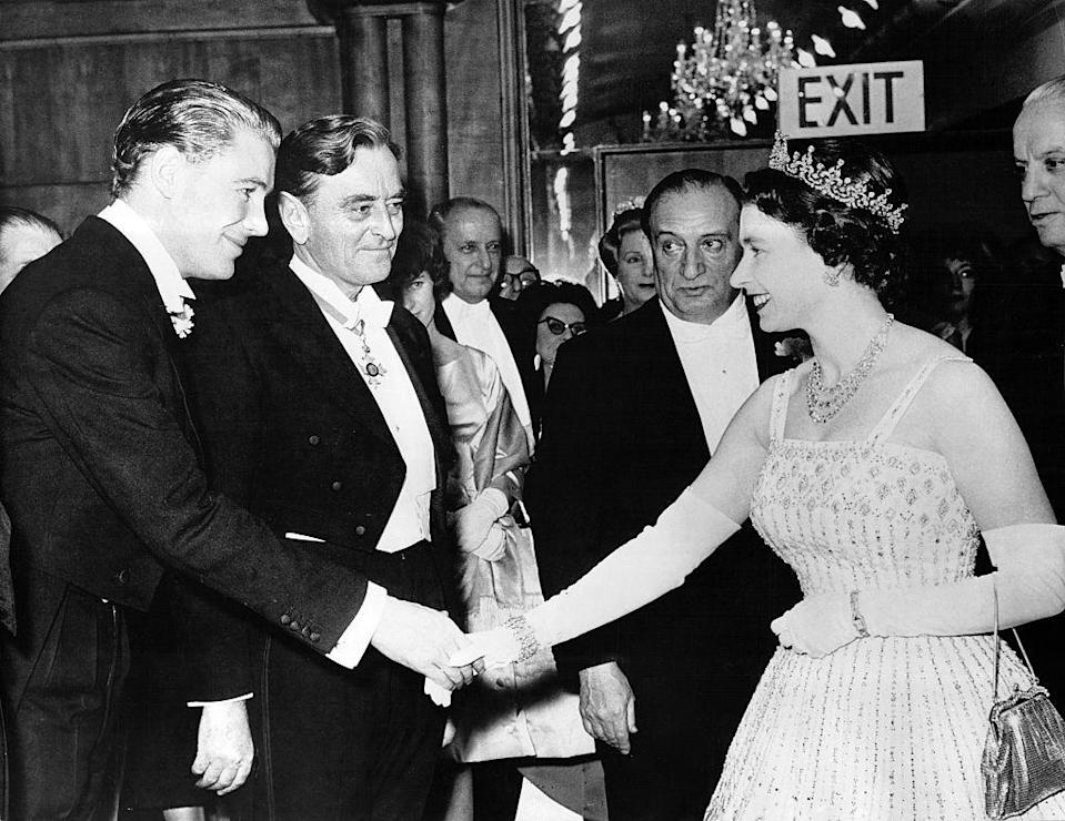 <p>Actor Peter O'Toole shakes hands with Queen Elisabeth II at the London premiere of <em>Lawrence of Arabia, </em>December 10, 1962. The movie took over a year to film and shot in locations all over the world, including Spain, Jordan, and Morocco.</p>