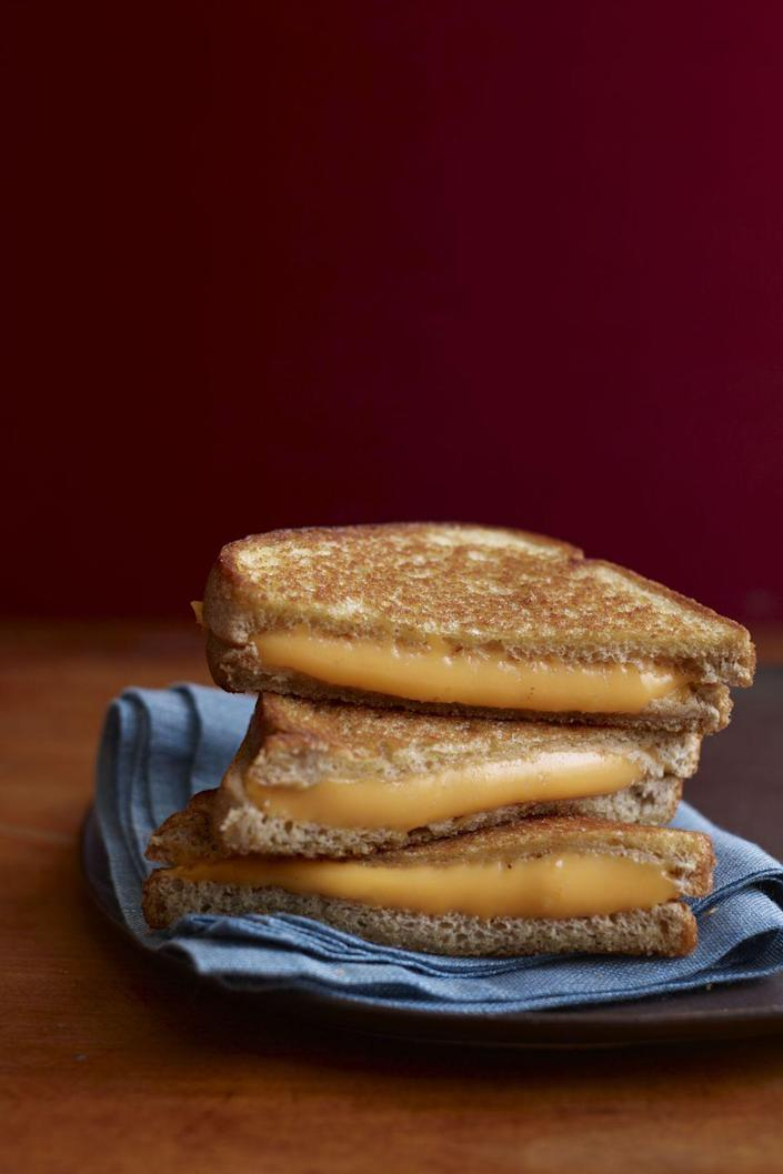 """<p>Let's start with the basics! Made with classic Pullman bread, cheddar, and butter you'll want to master this best-ever grilled cheese before going gourmet.</p><p><em><a href=""""https://www.womansday.com/food-recipes/food-drinks/recipes/a12182/basic-grilled-cheese-recipe-wdy1013/"""" rel=""""nofollow noopener"""" target=""""_blank"""" data-ylk=""""slk:Get the recipe for Classic Grilled Cheese Sandwich."""" class=""""link rapid-noclick-resp""""><strong>Get the recipe for Classic Grilled Cheese Sandwich.</strong></a></em></p>"""