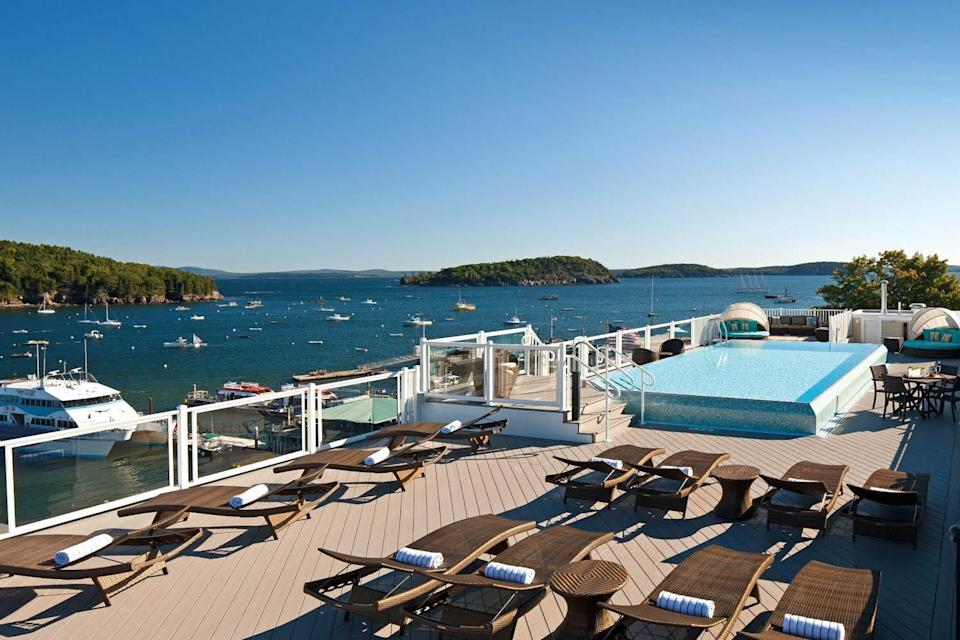 """The glittering lights and Blade Runner vibes of urban rooftop pools often get all the attention, but how many rooftop pools boast views of National Parks? The stylish <a href=""""https://www.cntraveler.com/hotels/bar-harbor/west-street-hotel?mbid=synd_yahoo_rss"""" rel=""""nofollow noopener"""" target=""""_blank"""" data-ylk=""""slk:West Street Hotel"""" class=""""link rapid-noclick-resp"""">West Street Hotel</a> in Bar Harbor is the only rooftop swimming pool in the state of Maine, and the only rooftop pool with views of <a href=""""https://www.cntraveler.com/story/maine-acadia-national-park-car-free?mbid=synd_yahoo_rss"""" rel=""""nofollow noopener"""" target=""""_blank"""" data-ylk=""""slk:Acadia National Park"""" class=""""link rapid-noclick-resp"""">Acadia National Park</a>. As an added bonus the pool is reserved for guests 18-plus, so you'll enjoy those rugged nature views with minimal disturbances."""