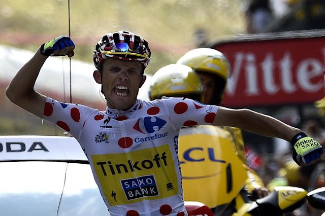 Poland's Rafal Majka wearing the best climber's polka dot jersey crosses the finish line at the end of the Tour de France 17th stage between Saint-Gaudens and Saint-Lary Pla d'Adet, southwest France on July 23, 2014 (AFP Photo/Eric Feferberg)