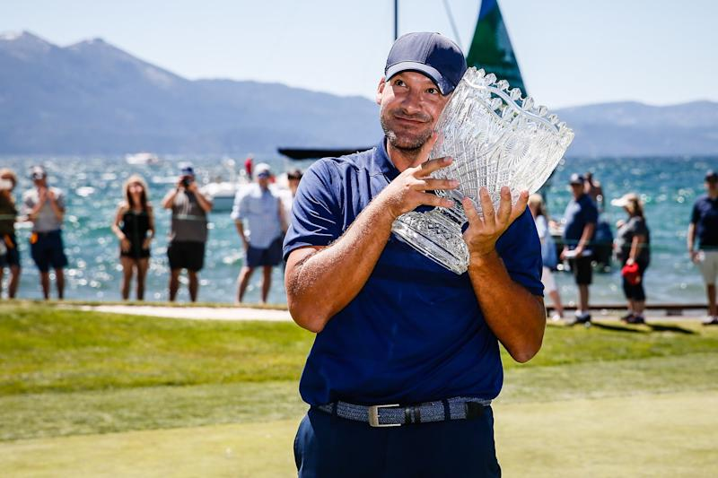 STATELINE, NEVADA - JULY 14: Tony Romo hugs the winner's trophy after winning the American Century Championship at Edgewood Tahoe Golf Course on July 14, 2019 in Stateline, Nevada. (Photo by Jonathan Devich/Getty Images)