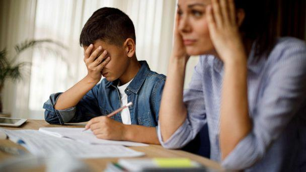 PHOTO: An undated stock photo depicts a stressed mother and son sitting at a table. (STOCK PHOTO/Getty Images)