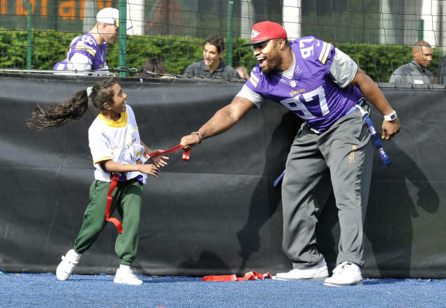 Everson Griffen of the Vikings takes part in a coaching clinic with London children near Wembley Stadium, London, Tuesday Sept. 24, 2013. The Pittsburgh Steelers are to play the Minnesota Vikings in the NFL International Series at Wembley Stadium in London on Sunday, Sept 29. (AP Photo/Sean Ryan, NFL)