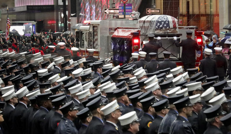 A fire truck leaves carrying the casket of U.S. Marine Corps Staff Sergeant and FDNY Firefighter Christopher Slutman, after his funeral service at St. Thomas Episcopal Church, Friday April 26, 2019, in New York. (AP Photo/Bebeto Matthews)