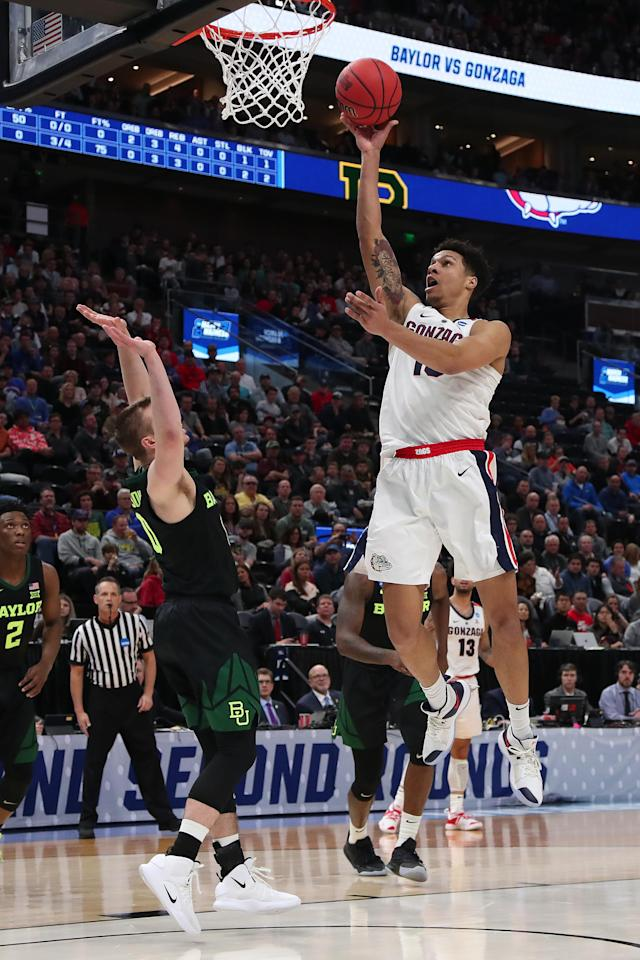 <p>Brandon Clarke #15 of the Gonzaga Bulldogs goes up for a shot against the Baylor Bears during their game in the Second Round of the NCAA Basketball Tournament at Vivint Smart Home Arena on March 23, 2019 in Salt Lake City, Utah. (Photo by Tom Pennington/Getty Images) </p>