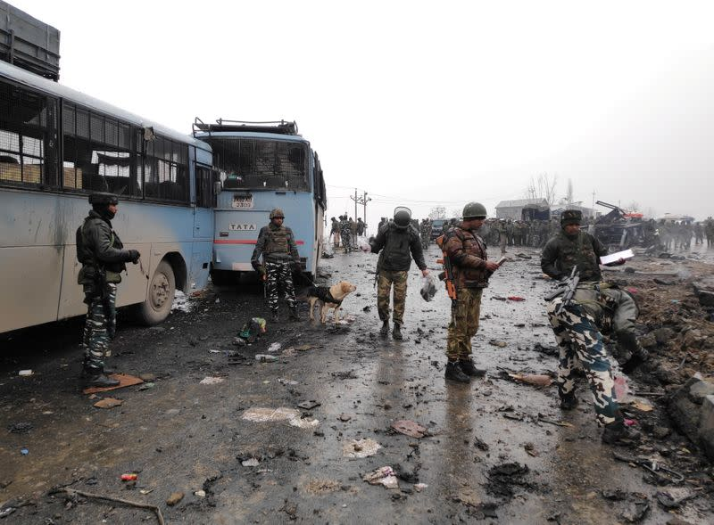 FILE PHOTO: Indian soldiers examine the debris after an explosion in Lethpora in south Kashmir's Pulwama district