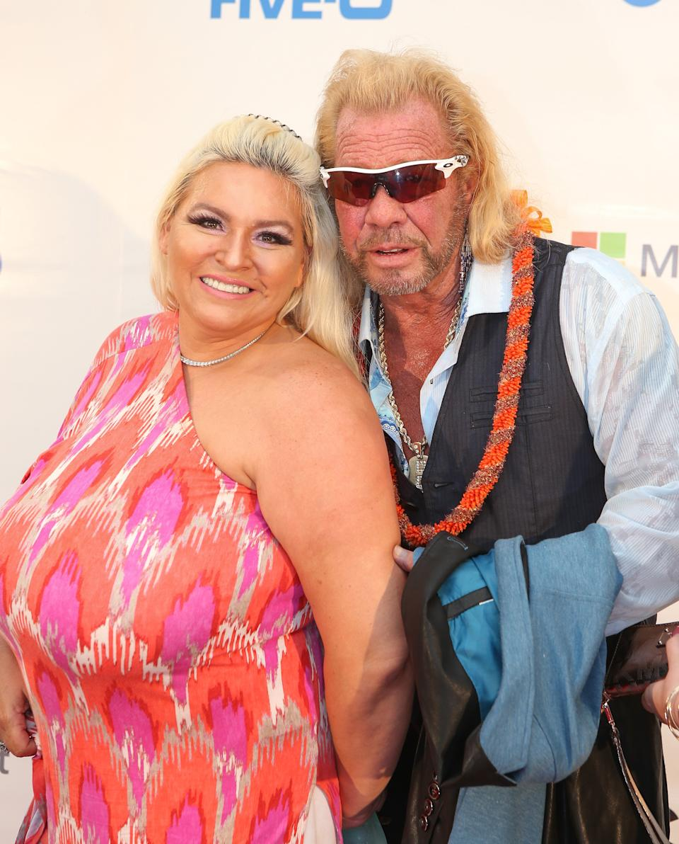 WAIKIKI, HI - SEPTEMBER 12:  Duane 'Dog' Chapman and his wife Beth Chapman arrive at the CBS 'Hawaii Five-0' Sunset On The Beach Season 6 Premire Event at Queen's Surf Beach on September 12, 2015 in Waikiki, Hawaii.  (Photo by Darryl Oumi/Getty Images)