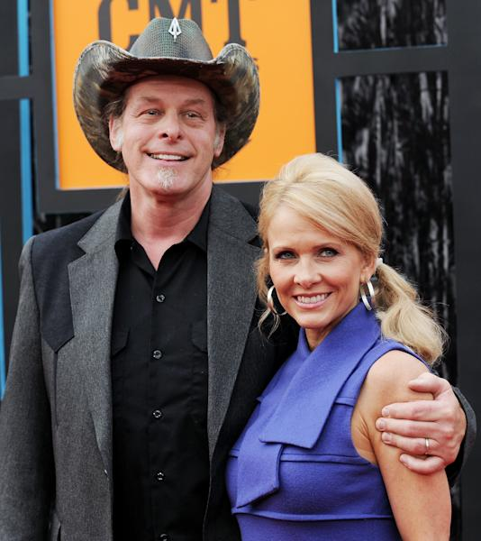 FILE- In this June 16, 2009, file photo, musician Ted Nugent and wife, Shemane Ann Nugent, arrive at the CMT Music Awards in Nashville, Tenn. Shemane Nugent has been arrested after a handgun was found in her carry-on luggage at an airport security checkpoint. Dallas/Fort Worth International Airport confirmed that Nugent was taken into custody Thursday, Aug. 29, 2013. (AP Photo/Evan Agostini/ File)